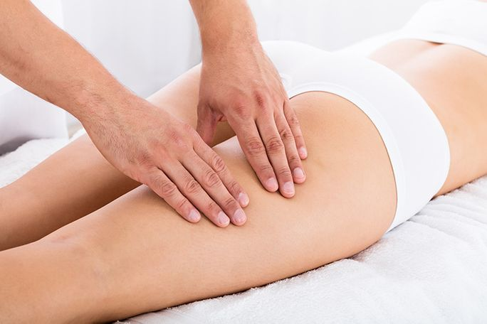 woman receiving full body massage